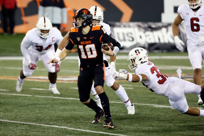 Dec 12, 2020; Corvallis, Oregon, USA; Oregon State Beavers quarterback Chance Nolan (10) scrambles out of the pocket to pass against the Stanford Cardinal during the first half at Reser Stadium. Mandatory Credit: Soobum Im-USA TODAY Sports