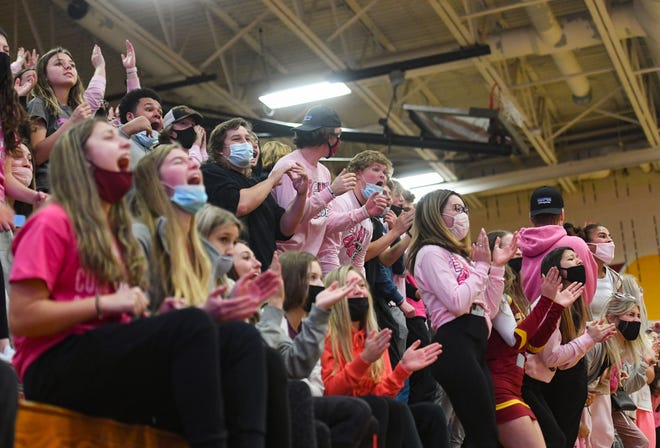 The Roosevelt student section yells after an exciting play on Saturday, December 12, at Roosevelt High School in Sioux Falls.
