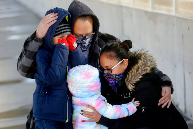 Aiden Jackson, left, Blake Jackson, Atticus Jackson and Jessica Green, who have all been staying at the Road Home's Midvale Family Shelter, pose for a portrait in Midvale, Utah, Wednesday, Dec. 2, 2020. (Kristin Murphy/The Deseret News via AP)
