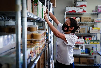 Capt. Patricia Torres stocks food pantry shelves in Ventura so the 300-plus local families who visit each month can get by.