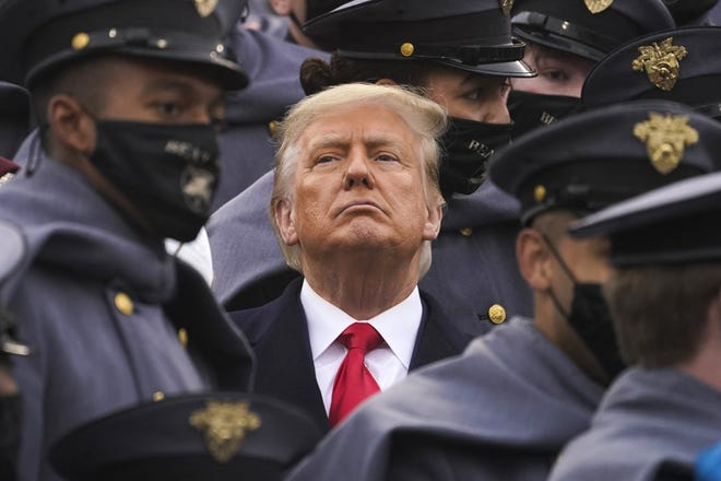 Surrounded by Army cadets, President Donald Trump watches the first half of the 121st Army-Navy Football Game, in Michie Stadium at the U.S. Military Academy on Dec. 12 , in West Point, New York.