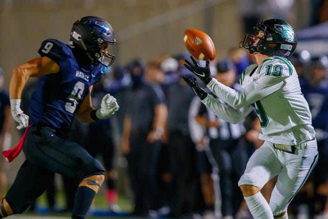 Cedar Park wide receiver Jack Hestera, catching a pass against Hendrickson, is among a talented group of offensive players who have helped the Timberwolves average 57 points a game.