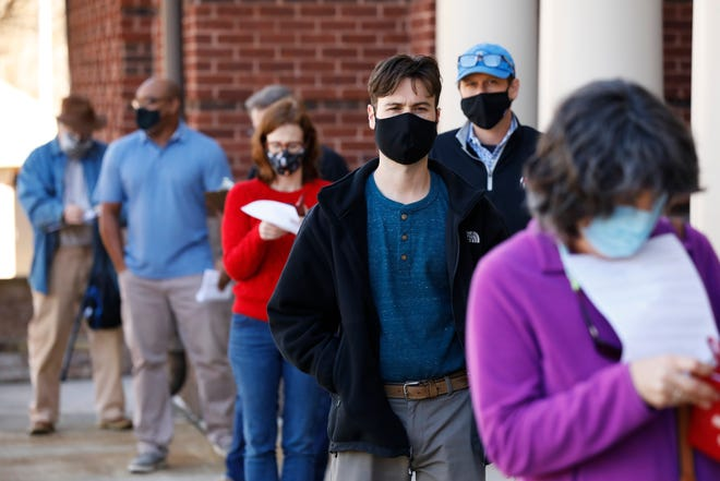 Voters line up on the first day of early voting for Georgia's U.S. Senate runoffs at the Lyndon House Arts Center in Athens, Ga., on Monday, Dec. 14, 2020. The Lyndon House is one of four sites open for early voting in Clarke County through Thursday. A fifth, the Extension Office on Cleveland Road, has been closed due to flooding. (Photo/Joshua L. Jones, Athens Banner-Herald)