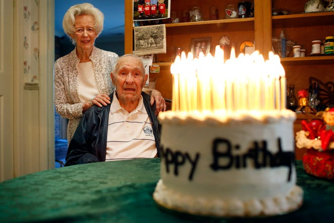 UGA football legend, and the oldest living UGA Pro Football Hall of Famer, Charley Trippi celebrated his 99th birthday with his wife Peggy at their home in Athens on Monday. They admire a cake, made by Joyce Phillips of Winterville, with 99 candles lit atop. (Photo/Joshua L. Jones, Athens Banner-Herald)