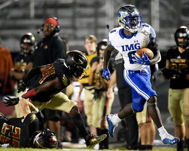 IMG Academy's Lovasea Carroll (6) runs in a touchdown against Ravenwood during the second half at Ravenwood High School in Brentwood, Tenn., Friday, Sept. 25, 2020.  Rhs Img 092520 An 021