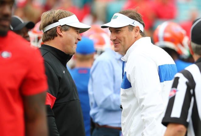 Nov 2, 2019; Jacksonville, FL, USA; Georgia Bulldogs head coach Kirby Smart (left) and Florida Gators head coach Dan Mullen greet prior to a game at TIAA Bank Field. Mandatory Credit: Kim Klement-USA TODAY Sports