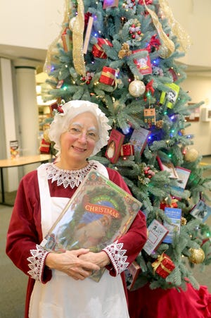 Stow-Munroe Falls Public Library Children's Librarian Evelyn Kremyar dresses up as Mrs. Claus throughout the Christmas season to read holiday books to kids.