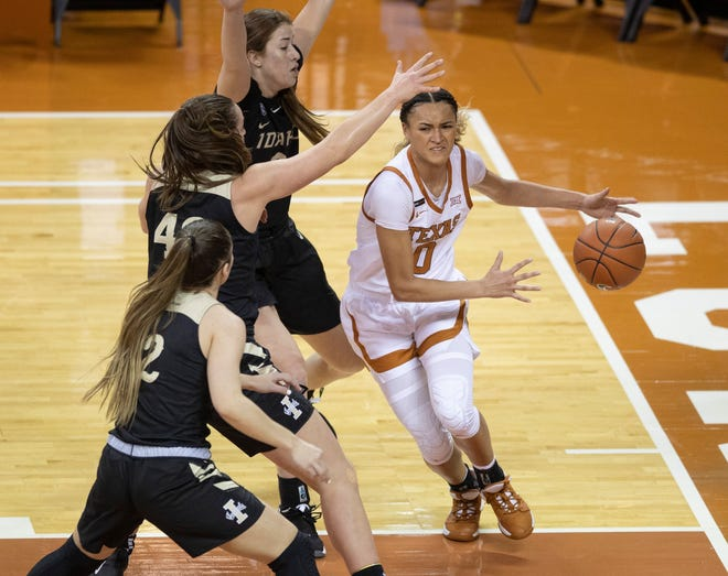 Texas guard Celeste Taylor drives to the basket against Idaho's Paris Atchley, Natalie Klinker and Nina Carlson at the Erwin Center on Dec. 9, 2020.