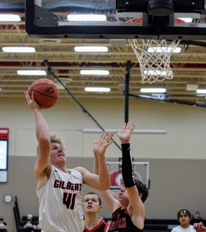Easton Johnson goes up for a shot during Gilbert's 71-54 loss to North Polk Friday at Gilbert. Johnson and the Tigers are trying to find their identity as a team following a couple untimely injuries that have contributed to a 1-3 start.