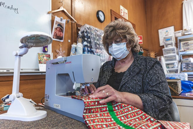 Tracey Hamilton works on a Christmas sewing project at Martha's Task, a nonprofit group that helps alleviate poverty among low-income women.