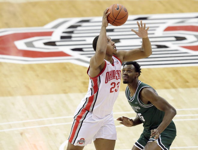 Ohio State Buckeyes center Zed Key (23) is guarded by Cleveland State Vikings forward Deante Johnson (35) during the second half of Sunday's NCAA Division I basketball game at Value City Arena in Columbus, Oh. on December 13, 2020. Ohio State won the game 67-61.