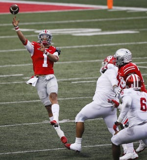 With 15 touchdown passes and three interceptions this season, Ohio State quarterback Justin Fields is expected to be named as the Big Ten's offensive player of the year Tuesday.