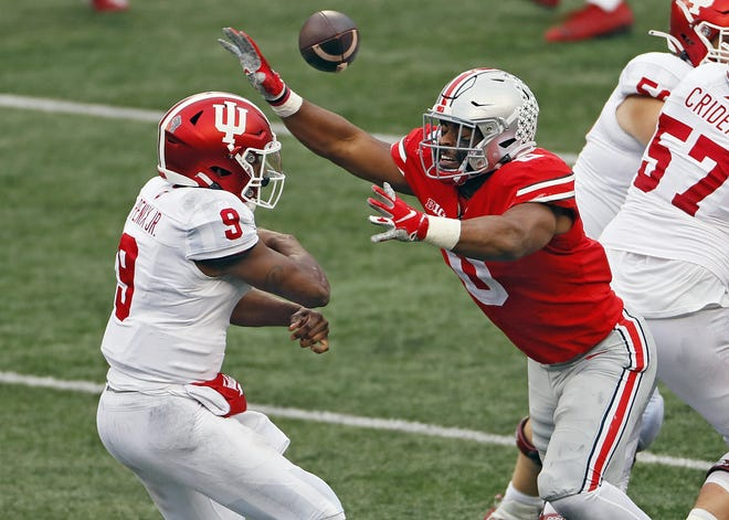Ohio State defensive end Jonathon Cooper bats away a pass while pressuring Indiana quarterback Michael Penix Jr. on Nov. 21.
