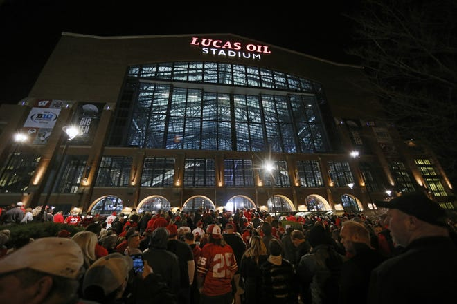 Fans file into Lucas Oil Stadium prior to the Big Ten Championship Game between the Ohio State Buckeyes and the Wisconsin Badgers in Indianapolis on Saturday, Dec. 7, 2019. [Adam Cairns/Dispatch]