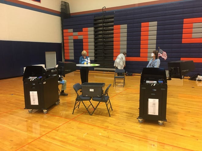 The Dominion ballot scanning machines in use on Election Day, Nov. 3, 2020 at the Penn Yan Academy gymnasium, Yates County's largest polling site.