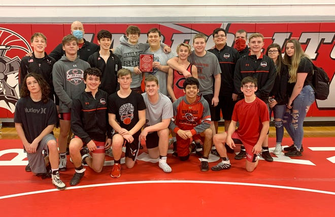 The Chillicothe (Mo.) High School wrestling Hornets emerged as undefeated champions of the Trojan Duals Tournament at Carrollton Friday, winning matches over Hamilton, Hallsville, Mexico, North Kansas City, and the hosts.