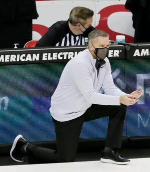 Ohio State Buckeyes head coach Chris Holtmann kneels on the court during the second half of Sunday's NCAA Division I basketball game against the Cleveland State Vikings at Value City Arena in Columbus, Oh. on December 13, 2020. Ohio State won the game 67-61.