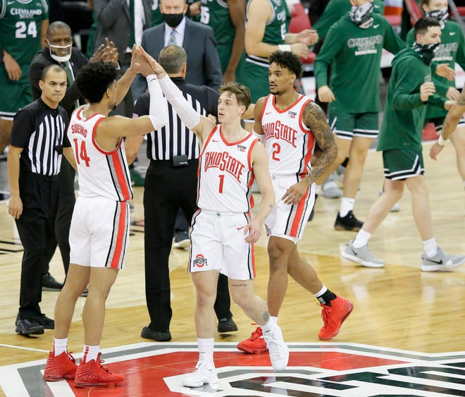 Ohio State Buckeyes guard Jimmy Sotos (1) is congratulated by Ohio State Buckeyes guard Musa Jallow (2) after scoring during the second half of Sunday's NCAA Division I basketball game against the Cleveland State Vikings at Value City Arena in Columbus, Oh. on December 13, 2020. Ohio State won the game 67-61.