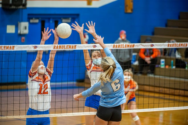Randleman's Sophie Macon blocks the spike of Trinity's Gracie Ballard in PAC-7 action on Dec. 7. Randleman fell in a five-set match with Providence Grove on Friday.