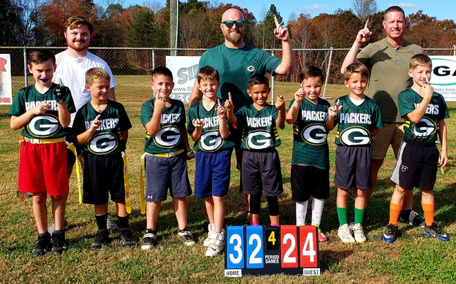 The Arcadia Packers won the 2020 Davidson County U8 flag football Super Bowl. Team members are (back row, from left) coaches Dylan Beasley, David Beasley, Brian Jackson; (front row, from left)  Liam Henslee, Blake Godwin, Carter Shook, Eli Maggard, Romauldo Duarte, Gavin Beasley, Colby Maggard and Max Jackson.