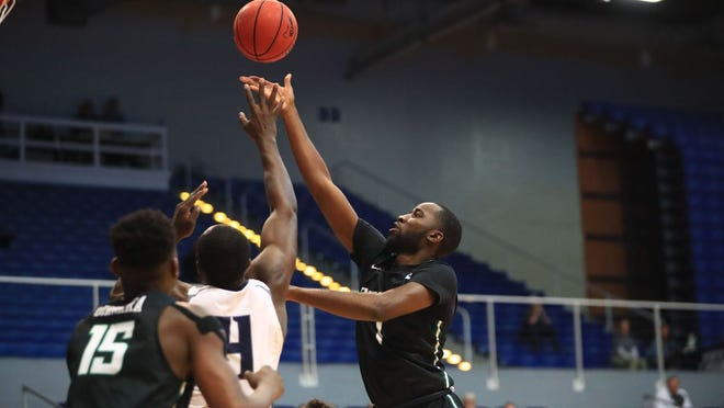 Sophomore Wheza Panzo, right, goes up for a shot in a recent Stetson men's basketball game as Mahamadou Diawara (15) gets ready to help. The Hatters are back in action Tuesday night at home against FAU at 7 p.m., Dec. 15, 2020.
