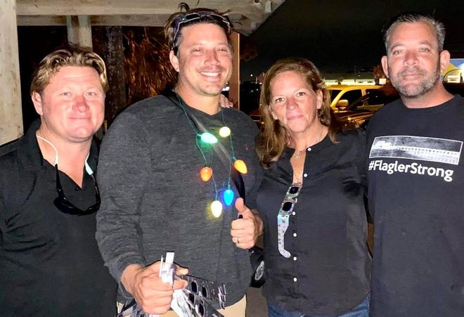 Tortugas' Florida Kitchen & Bar co-owner Scott Fox, A1A Burrito Works and Wham Burger owner Nick Kimball, Swillerbees Craft Donuts and Coffee Bar owner Shannon Willer and Tortugas' Florida Kitchen & Bar co-owner Paul Chestnut enjoy the view as the stars light up on the Flagler Beach Pier Friday evening.