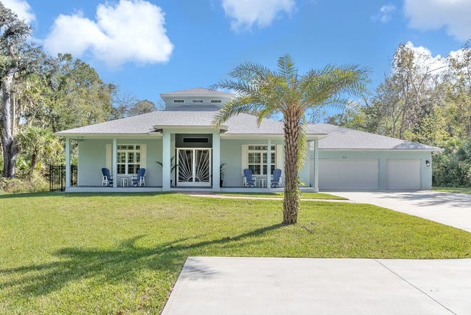 """This picturesque Key West-style pool home sits on 2.5 acres of """"fairytale"""" wooded property in the heart of Ormond Beach."""