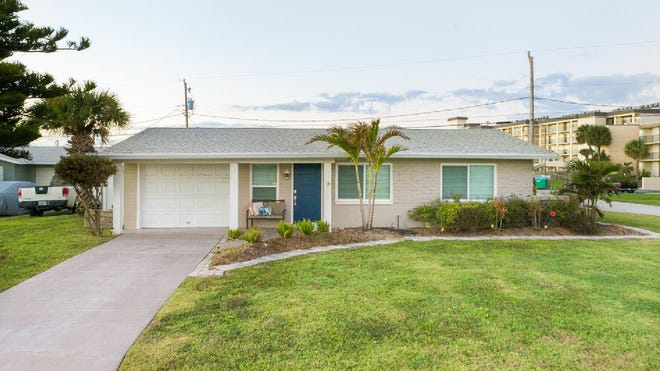 This immaculate, updated home is just a few steps from the ocean and one house from the beach.
