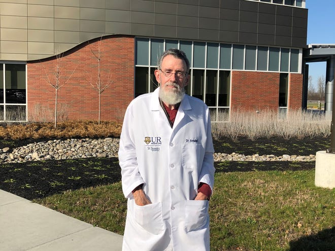 Dr. Spencer Annabel of Canisteo stands in front of St. James Hospital in Hornell, where he will leave a profound legacy after nearly 50 years of service.