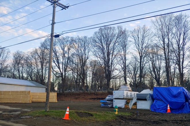 Construction materials stand ready at the site of the Town of Wellsville's future home on West Hanover Street.