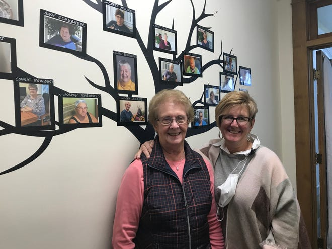 Sharyl Brown, Vincent House treasurer and Kim Snyder, Vincent House executive director celebrate 20 years.