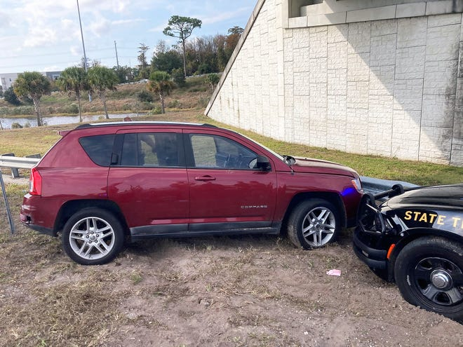 The red Jeep after a Florida Highway Patrol trooper used the PIT maneuver to spin and stop in at I-95 and Butler Boulevard.