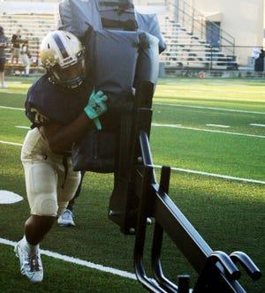 University Christian's team runs through blocking drills at high school football practice on December 10, 2020. [Clayton Freeman/Florida Times-Union]
