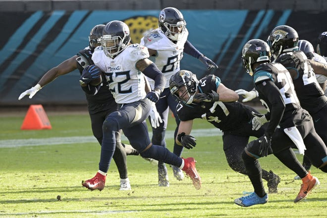Running back Derrick Henry (22) rambled for 215 yards as the Tennessee Titans bullied the Jaguars into early submission Sunday in a 31-10 victory.
