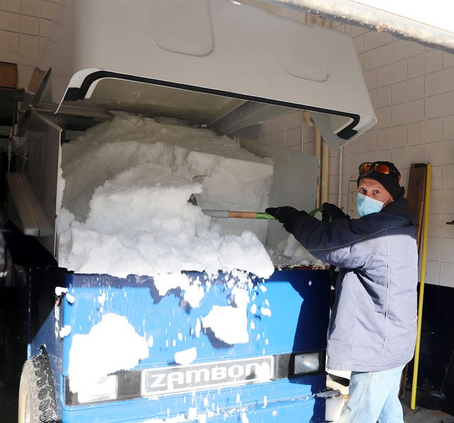 Scott Demont, manager of Gardner Veterans Arena, shovels away some of the 125 cubic feet of shaved ice accumulated after a complete ice cleaning with the Zamboni.