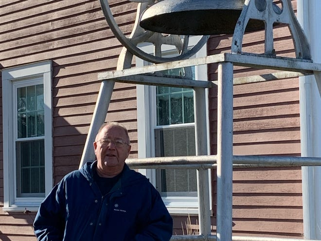 """Steve Stone is shown by one of Andover's oldest bells which he will ring at """"Ring the Bells at Christmas!"""" event planned by the Andover Tourism Council."""