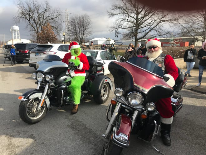 Santa and his helper the Grinch arrived in Galva Sunday  early afternoon on motorcycles. They visited children in Veterans Park and passed out candy. The pair toured several towns Sunday in Central Illinois bringing Christmas cheer.