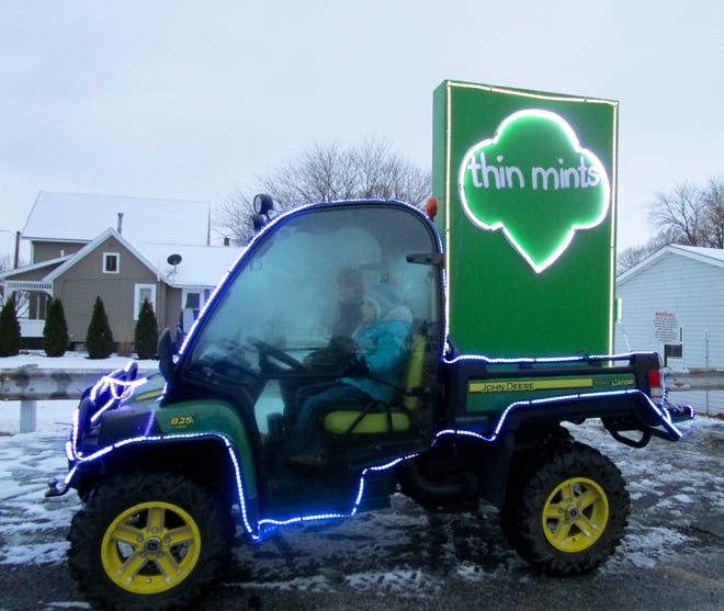 """The Geneseo Girl Scouts were represented in the 2020 Geneseo Christmas Walk Lighted Parade with their float, """"Thin Mints,"""" a favorite Girl Scout cookie."""