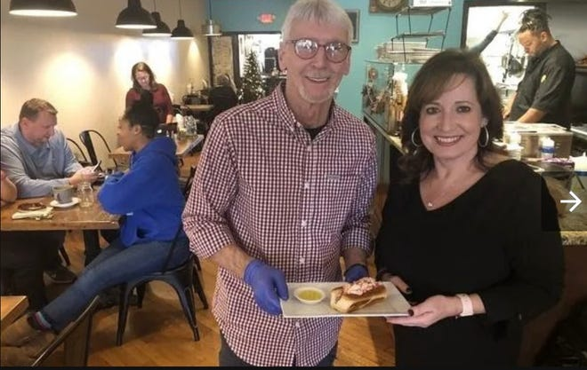 Denise Mehl, right, announced Sunday that she will close her restaurant, The Crepe Factory, at the end of the year. Here, she stands with Bobby Beauvais, former owner of Hub Diggity Dogs, in Dec. of 2019.