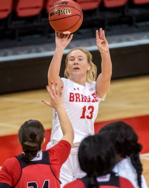 Bradley's Tatum Koenig puts up a three-pointer over the Northern Illinois defense Sunday, Dec. 13, 2020 at Renaissance Coliseum. The Braves defeated the Huskies 79-71.