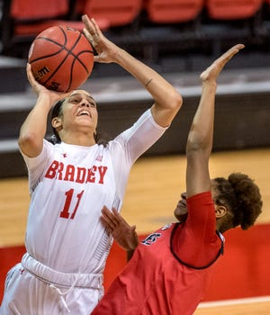 Bradley's Lasha Petree (11) shoots over the Northern Illinois defense in the third quarter Sunday, Dec. 13, 2020 at Renaissance Coliseum. The Braves defeated the Huskies 79-71.
