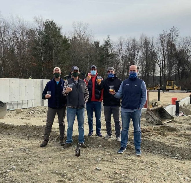 Gathering at the Industrial Drive site where the Holden business is building a new brew house, 7 Saws founders show off their favorite brews, from left, Troy Milliken, Tom Anderson, Thomas Mulroy, Paul Mulroy and Greg Cedrone.