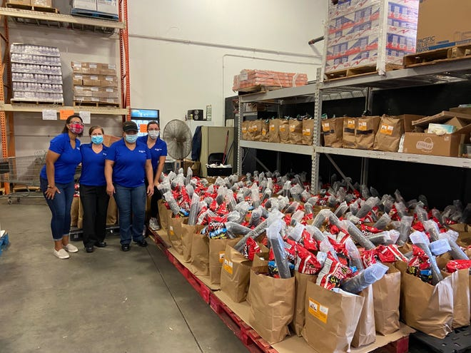 Volunteers with Texas Health Hospital Mansfield stock a food bank for the local community recently. Instead of holding a grand opening in the middle of a pandemic, the hospital donated funds to local nonprofits.