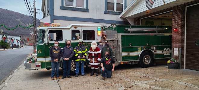 """Potomac Fire Company of Westernport helped put a smile on kids and adults alike this Christmas with a Santa run-through in Westernport, Luke, and McCoole, the company's first due area. """"This was a great way to put a bright spot in 2020, and we were happy to help out Santa with a lift,"""" said Jonathan Dayton, PIO. Pictured with Santa are:  Firefighter Jim Mertz, chief Tim Dayton, deputy chief Bill Kight, firefighter Zach D., firefighter Mark Karalewitz, and firefighter Noah Cummings."""