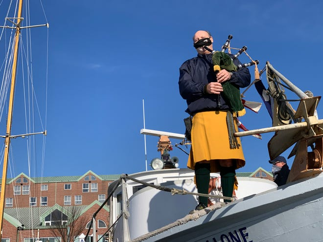 Bob Novick played bagpipes during an on-the-water tribute to the late Tim Mills on Sunday.
