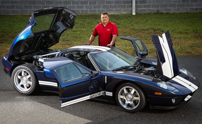 Conservator Jean Morillo stands next to the 2006 Ford GT out of the Schmidt Family Collection in Ocala on Dec. 14. The car is powered by a mid-engine 90-degree DOHC 32-valve supercharged V-8 5.4L with 550 hp. The car has 1,200 original miles and has a curb weight of 3,485 pounds.