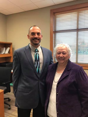 New Crawford County Library System Director George Fowler stands with the previous director, Eva White.