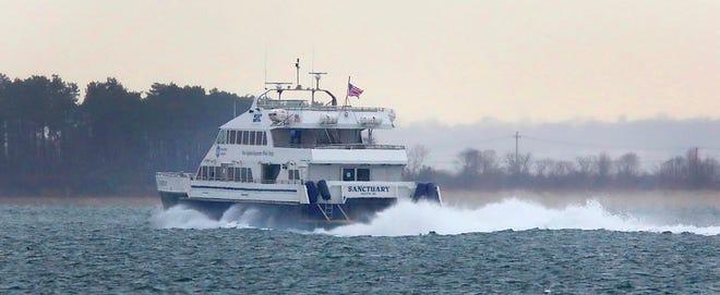 "The commuter boat ""Sanctuary"" motors to Boston past Quincy in sleet and rain Monday, Dec. 14, 2020. Greg Derr/The Patriot Ledger"