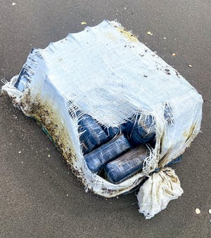 Seventy pounds of cocaine bricks washed ashore near Via La Selva on the 800 Block of South Ocean Boulevard on Saturday. The packages have a street value of $850,000, police said.