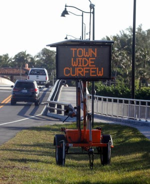 Flashing signs at bridges let those traveling into town know that a town-wide curfew from 1 a.m. to 5 a.m. is in effect.